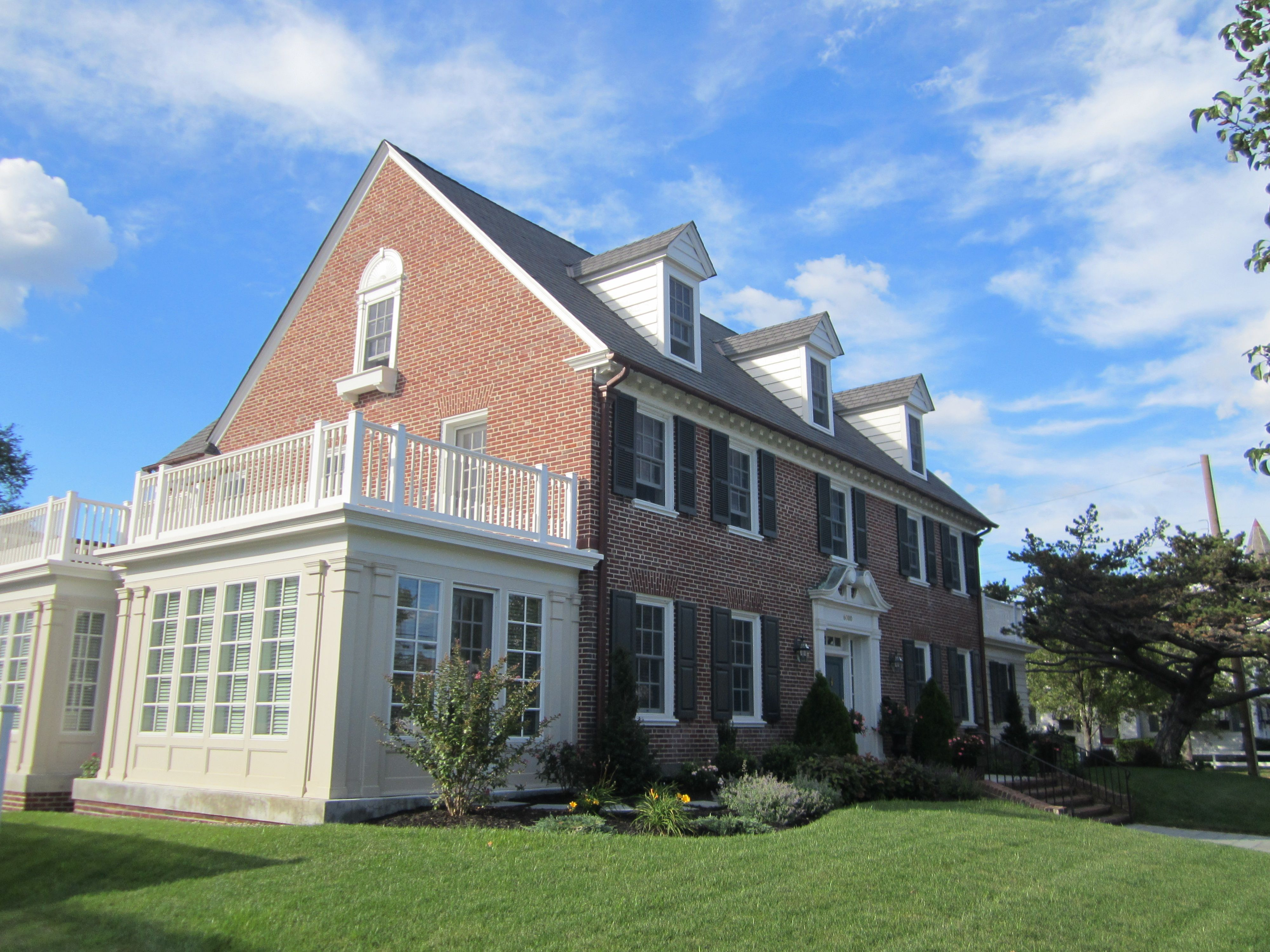 Red brick colonial style houses with putty color trim and for Colonial home additions