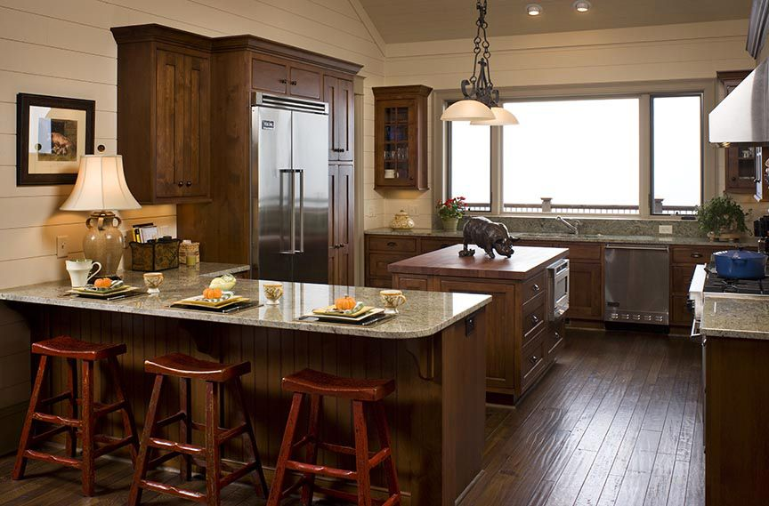 Clear alder cabinets and hand-scraped walnut flooring ...