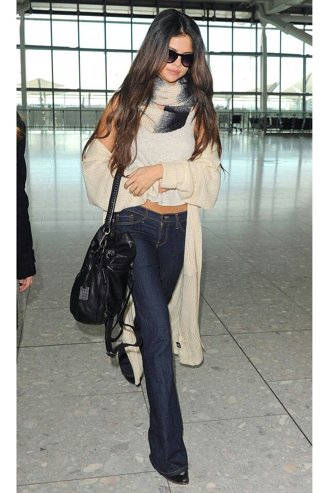 Selena Gomez hits the airport in sleek flares and layered knits.