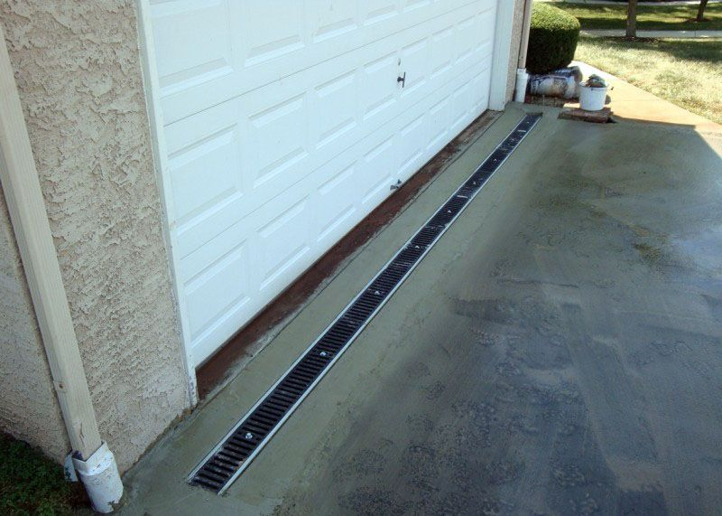 Many Homes Have Driveways That Slope Towards The Garage Or Home During Rainstorms Water Can Flow Onto Your Pr Drainage Solutions Yard Drainage Exterior Doors