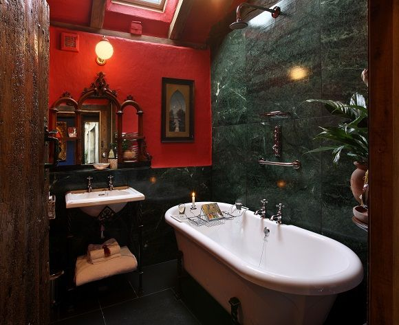 quirky luxurious bathroom with marble wall and digital shower