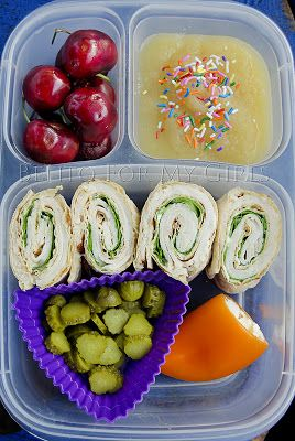 Today's lunch is turkey/spinach wrap, pickles, orange bell pepper stuffed with cream cheese, cherries and applesauce.