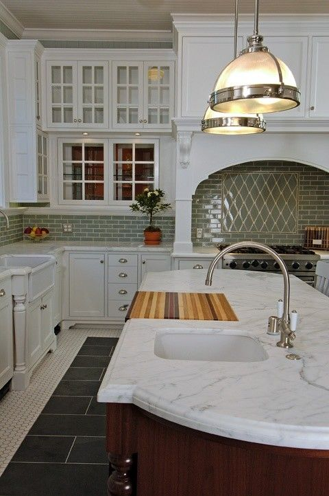 Kitchens vintage penny tiles floor slate inset coffee stained kitchen island creamy white glass front cabinets marble countertops farmhouse also