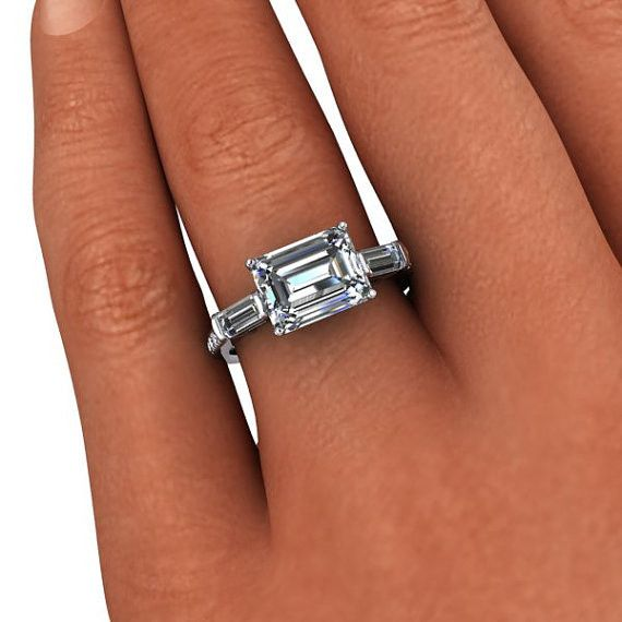 1ed97e12fa297 A diamond and Moissanite east west engagement ring featuring a 2.50 ...