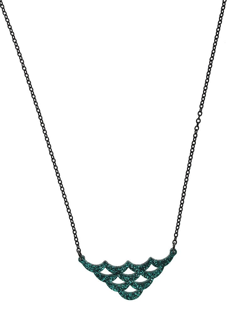 """A scaled down version of our Glitter Teal Ice Mermaid Scale necklace. - 16"""" silver plated chain - Charm measures 2"""" wide by 1"""" tall - Glitter teal ice acrylic"""