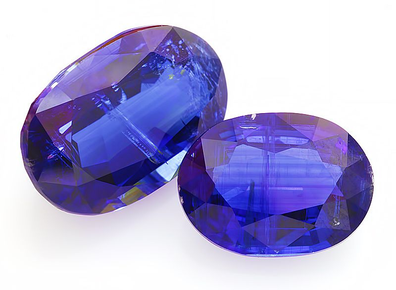 """Fine quality Kyanite may be confused in appearance with spinel or blue sapphires from Burma.  Kyanite name derives from the Greek word """"kyanos"""", meaning deep blue. Kyanite is also of interest because of the extreme variablity in hardness with direction. In one direction, the hardness is 4.5 and in the other it is 7. Very easy cleavage is encountered in one direction with a less perfect cleavage occurring at 74 degrees to the first."""