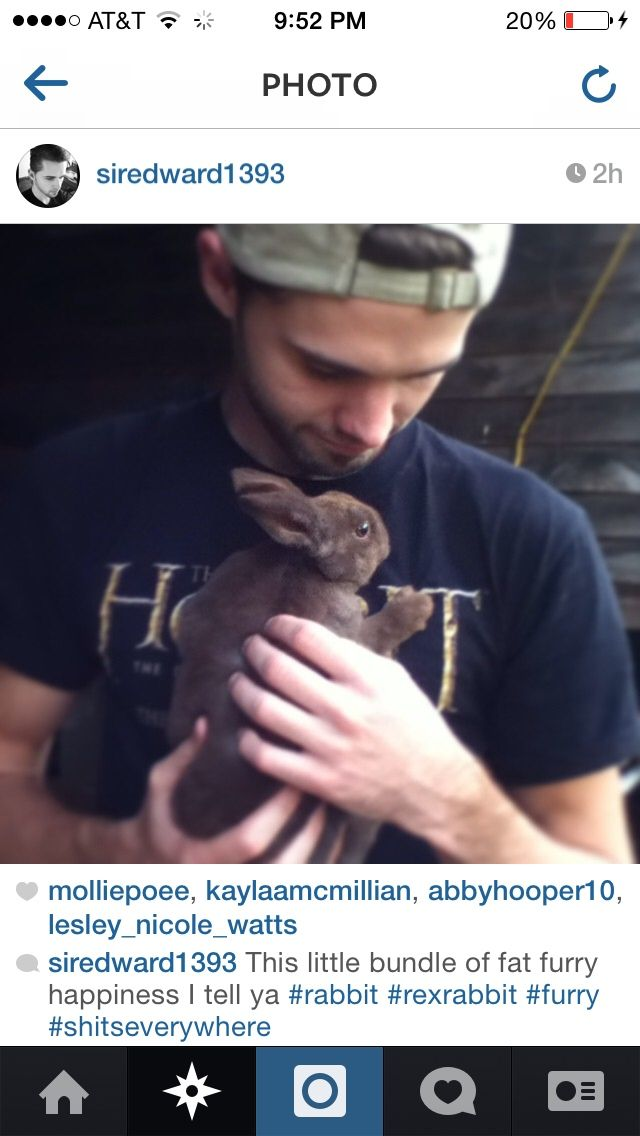 Cute boy... Holding a rabbit...Sporting a Hobbit shirt