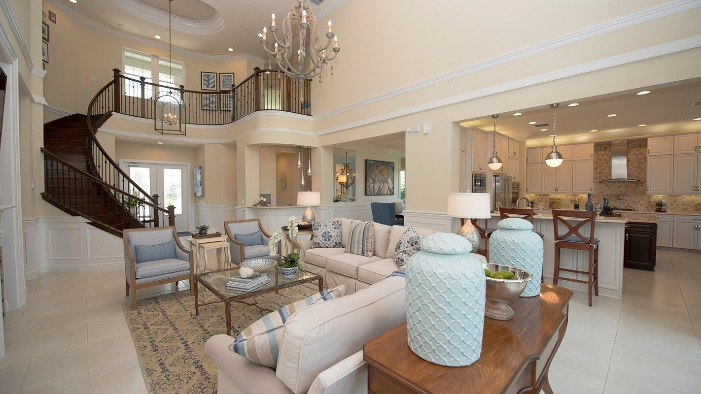 A Winding Staircase Leads To A Great Room And Kitchen The