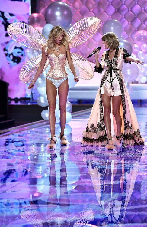 d67a3eab72 Victoria s Secret · US model Karlie Kloss (L) walks the runway next to US  singer Taylor Swift