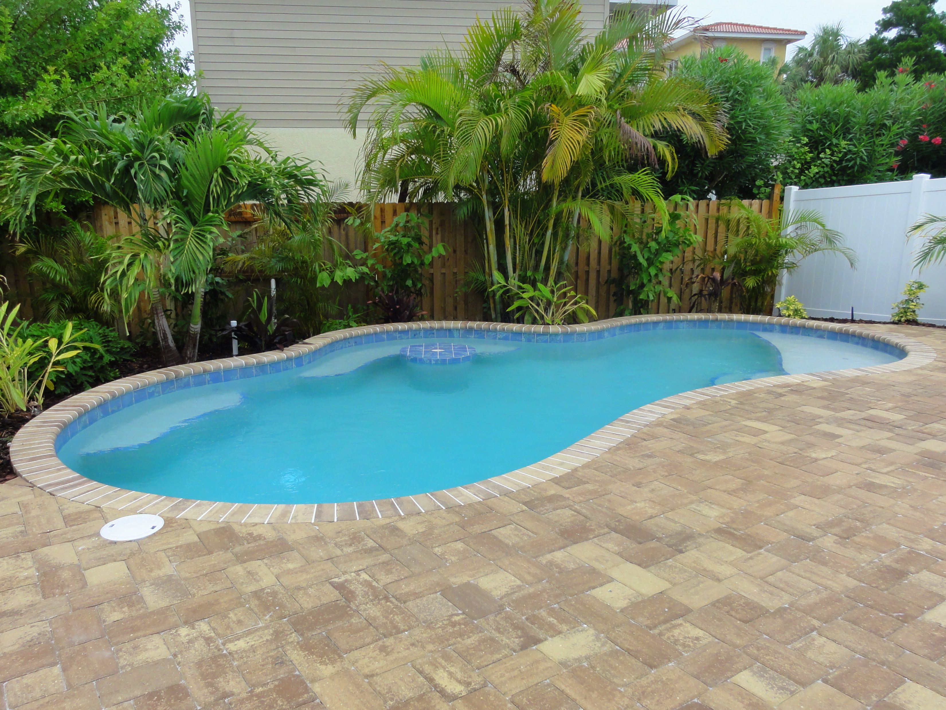 Perfect size beach pool for small backyards cocktail table and