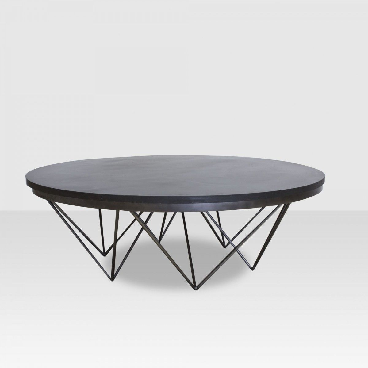 Low Round Coffee Table With Thin Legs Or Base. Safer For Kids, Creates More