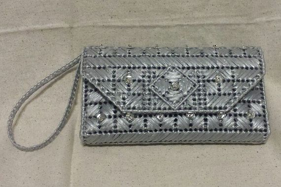 The Crossed Paths Design - Matching Handbag available for only $55.00. Be You, Be Classy, Be Sassy! Beautiful mix of colors, perfect for any season. The Helena Sassy Bags are handcrafted, beautiful and artistic, each with a unique design and its very own personality, not done in series... truly One of A Kind! We use only quality materials to create a very classy and sassy product that will match any occasion and attire. Made with recycled plastic canvas and with 100% rayon raffia/fabric...