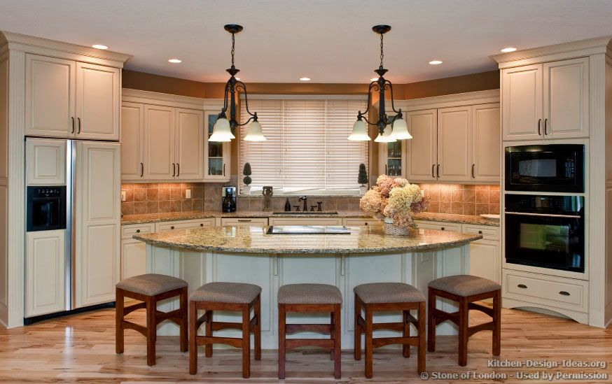 triangular kitchen islands with seating | ... kitchen features an open-plan  layout