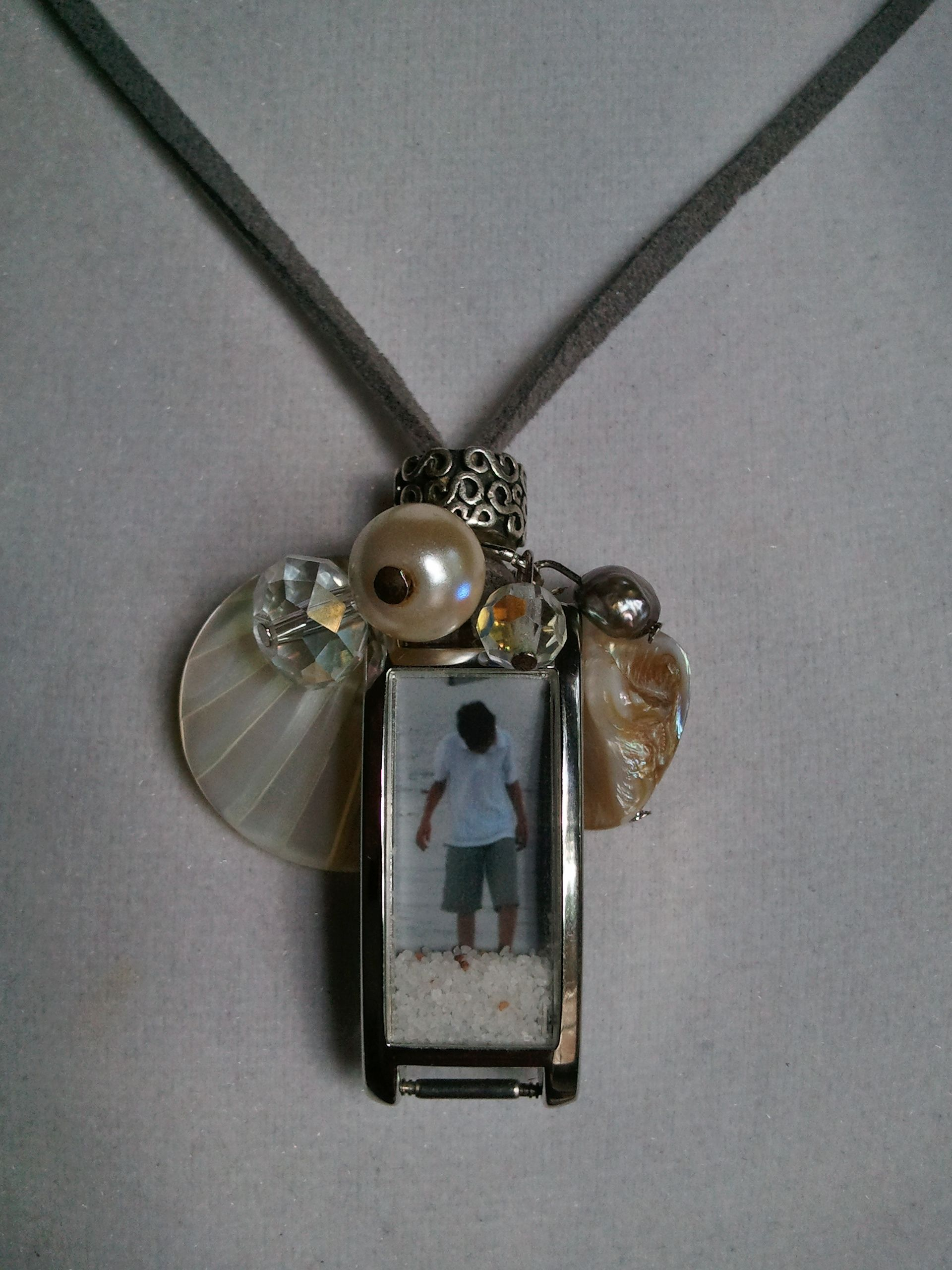 Turn old watches into lockets, this one I also added real sand from the beach inside with the photo to give depth.