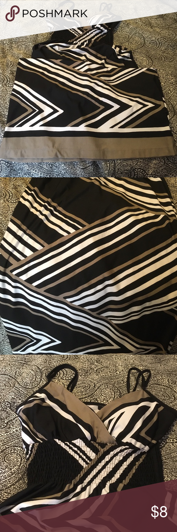 Diagonal stripe maxi dress. Diagonal criss-cross maxi dress with adjustable straps. This dress has been used a bit but still has plenty of life left.  The colors are black, white, and deep khaki/dusty olive. Snap Dresses Maxi