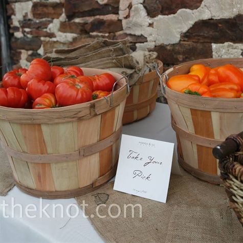 LOVE THIS IDEA!!!!  Amanda's love of gardening dictated the couple's favors: local produce (heirloom tomatoes and bell peppers) set out in wooden baskets for guests to snag.  Guests carried their treats home in small burlap sacks, which had been stamped with Amanda and Teil's wedding logo.
