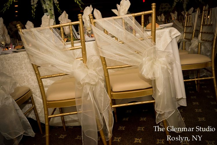 Ivory organza sash - a delicate touch for the gold chiavari chairs.