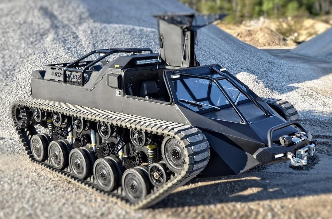 In light of all of the angry comments over yesterday's post. Here's a Ripsaw. A remote control tank with no guns. Only a winch that it will never need.