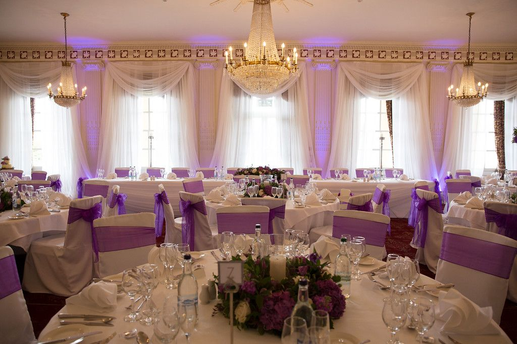 wedding chair cover hire brighton chairs for tweens gorgeous cadburys purple theme bespoke linen covers with draping and uplighters floral centrepieces from pollen flowers