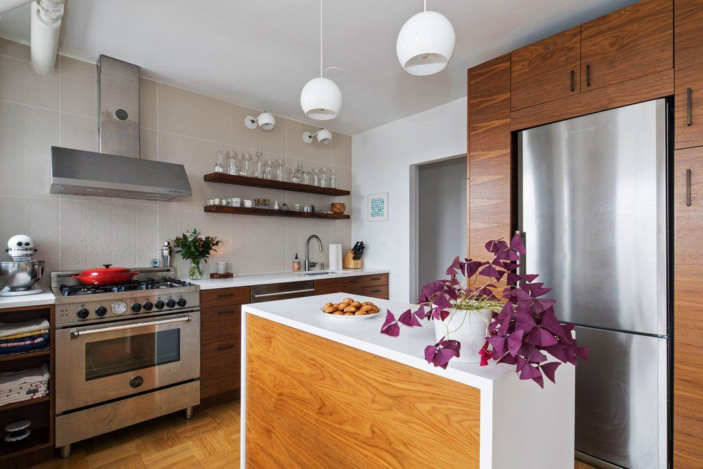 A trio of neighbors living in the same apartment complex in Clinton Hill, Brooklyn, created three very different spaces out of the same basic B-Line kitchen. Sarah Lantz and Becky Froman used floatingwalnut shelves and bright white counters to create an open, airy feel.