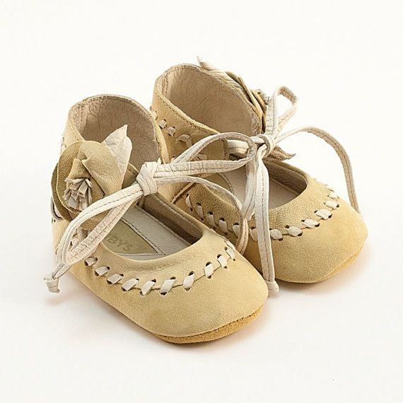 Baby shoes made from stitched leather and embellished от Vibys