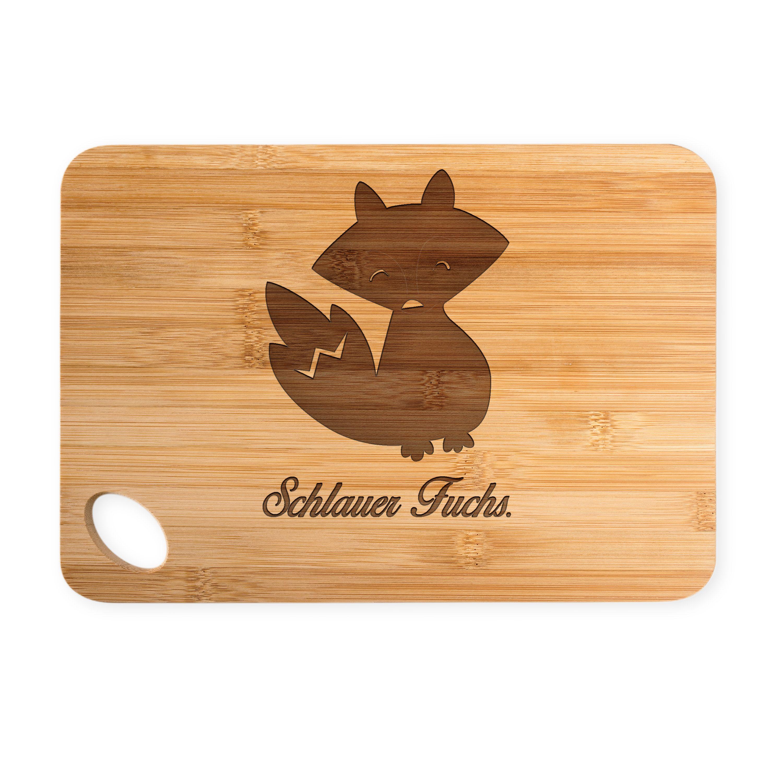"""Bambus - Schneidebrett Fuchs Deluxe aus Bambus   Natur - Das Original von Mr. & Mrs. Panda.  Ein wunderschönes Holz-Schneidebrett von Mr.&Mrs. Panda.    Über unser Motiv Fuchs Deluxe  Füchse sind zauberhafte verspielte Waldbewohner, die ein süßes Accessoire sind und jedermann gefallen. Unser Fuchs """"Deluxe"""" ist zeitlos schön und ist das perfekte Design für Fuchs Liebhaber, Waldfreunde, Trendsetter, Tierliebhaber, schlaue Füchse und Geschenksuchende.    Verwendete Materialien  Wunderschönes…"""