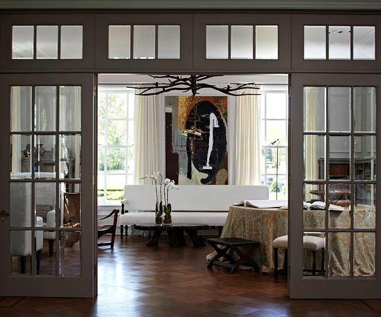 Door Designs Glass French Doors  Like windows, doors are a key part of any wall's composition. Here, beautiful French doors separate the living room from a large foyer, while still letting light flow freely between rooms. Incorporating a pair of French doors into a living space allows you to add a little old-fashioned charm.Glass Fren...