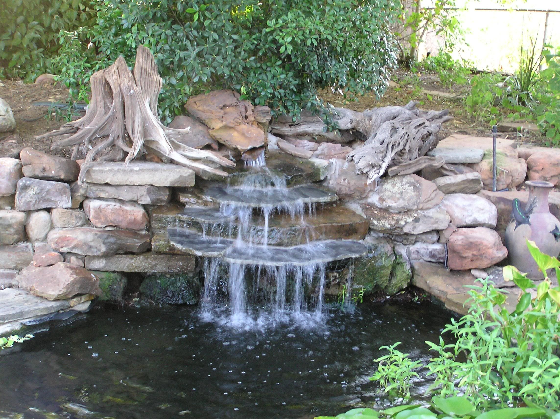 Landscape fountains garden waterfall design 5 for Fish pond fountain design