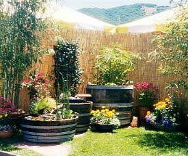 A 3 Tier Split Barrel Water Garden In Graduating Smaller Sizes.