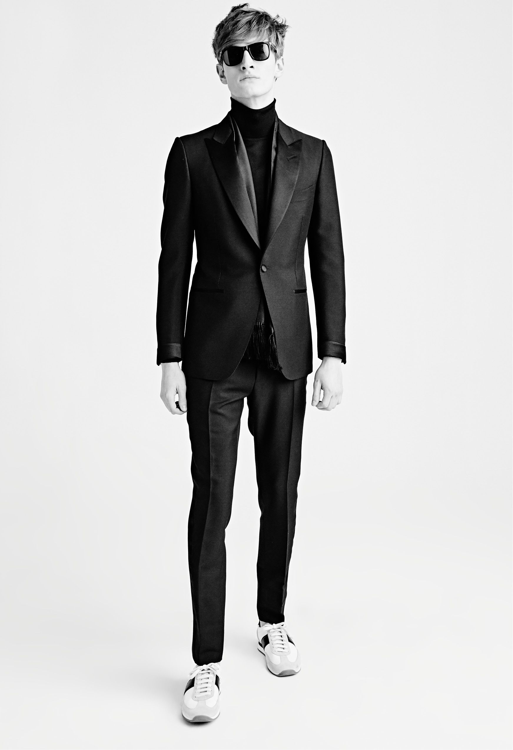 MEN'S AW15 LOOK 26 | Black overdyed mélange mohair satin peak lapel buckley cocktail jacket. Black classic cashmere turtle neck. Black overdyed mélange mohair satin trim buckley evening pants with belt loops. Black leo sunglasses. Black silk evening scarf with fringe. White suede textile and leather orford runner with black details.