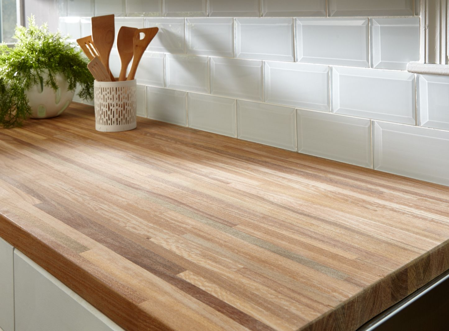 White Beveled Glass Tile And Butcher Block Countertop