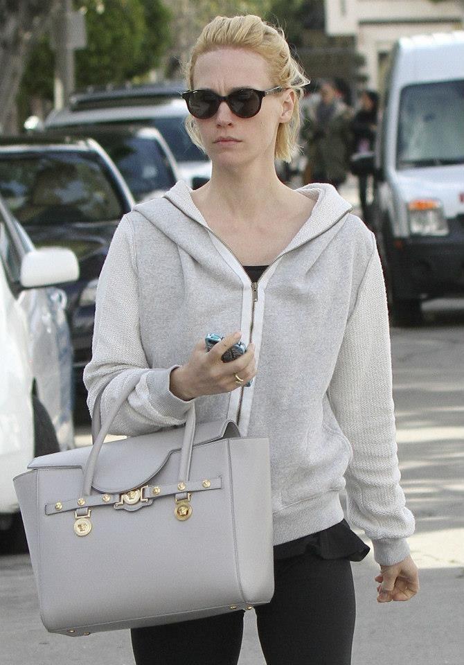 January Jones carrying a stunning  Versace Signature bag.   VersaceSignatureBag  VersaceCelebrities 2b66e68b590ce