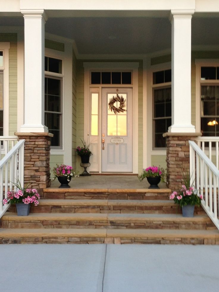 Stone Pillars And Front Of Steps With Stamped Concrete Front