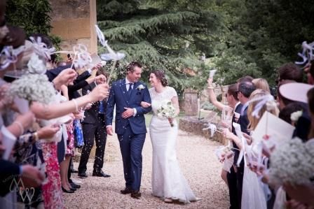 Romantic and charming wedding exit created at this French Chateau using confetti and wands Photo by Matthew Weinreb, The wedding photography Guru www.theweddingphotography.guru