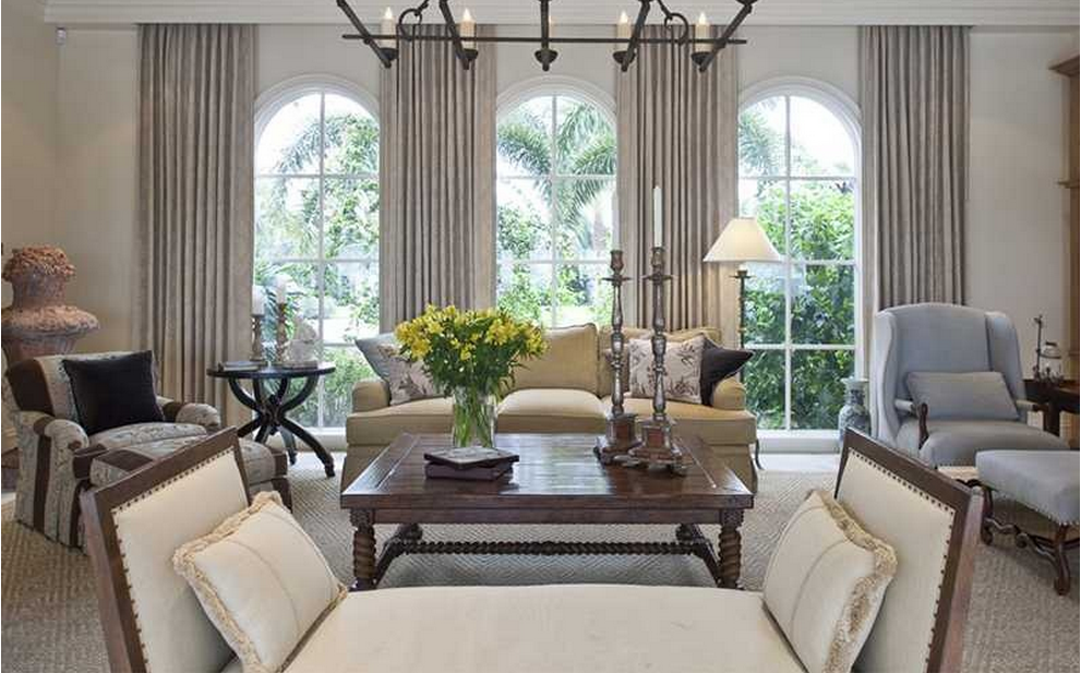 Gray drapes do not hide the arched windows. Window treatments can ...