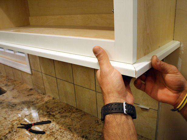 how to install a kitchen cabinet light rail how to diy network rh pinterest com how to install a kitchen cabinets how to install a kitchen cabinet door