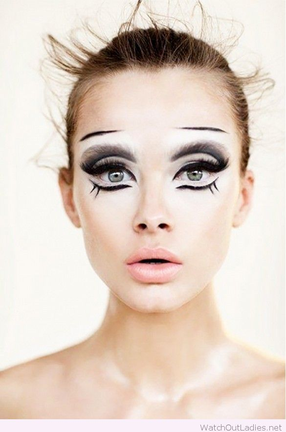 Animalistic, doll-like face paint with different layers and ...
