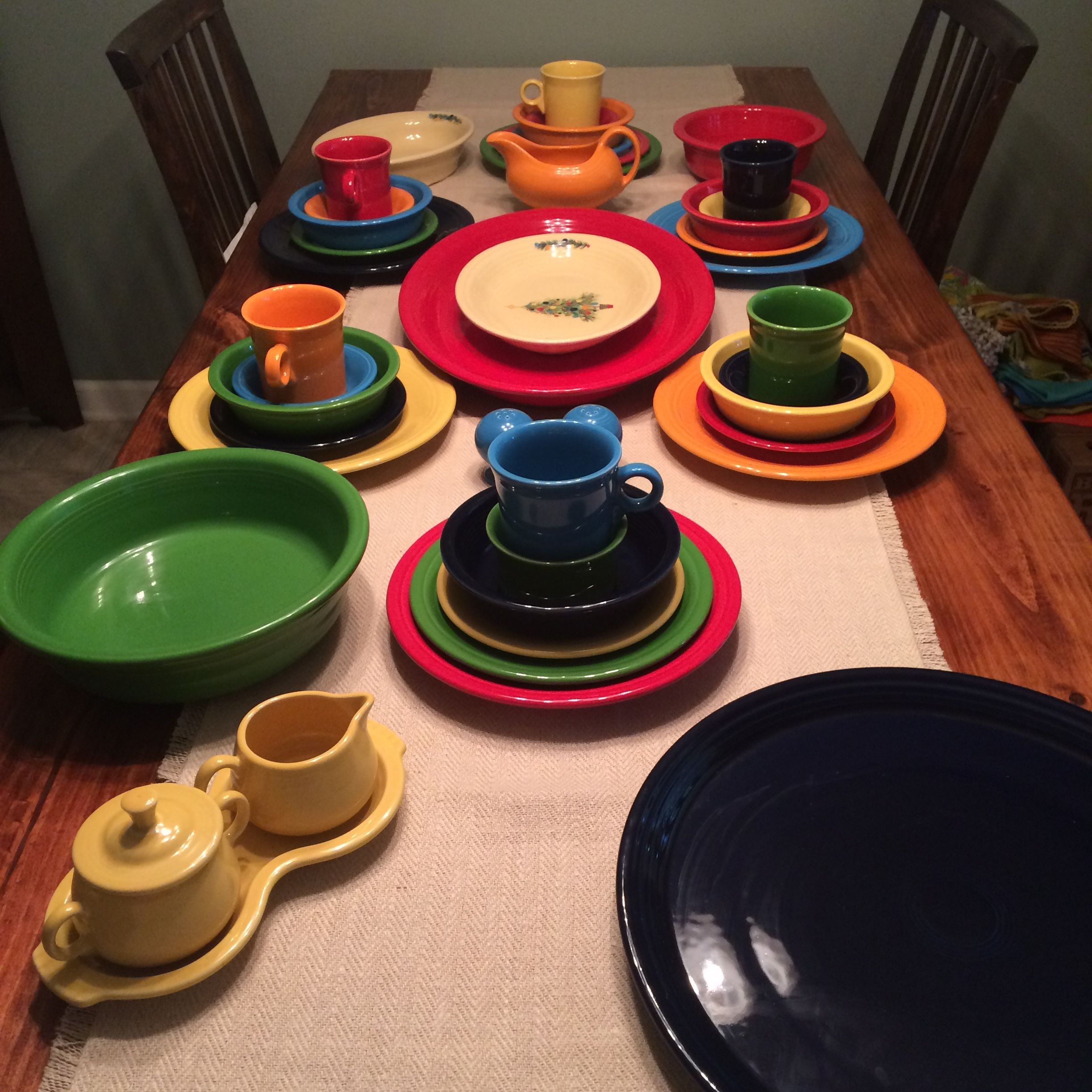 Bright and festive Christmas fiesta ware: cobalt, scarlet, shamrock, sunflower, tangerine, and peacock, with christmas tree serve ware on an ivory background