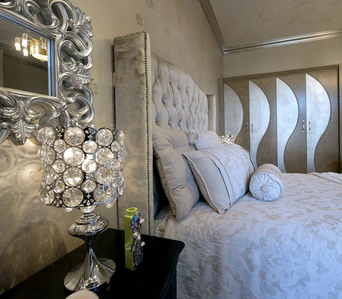Silver leaf closet door art and crystal lamp add texture and bling