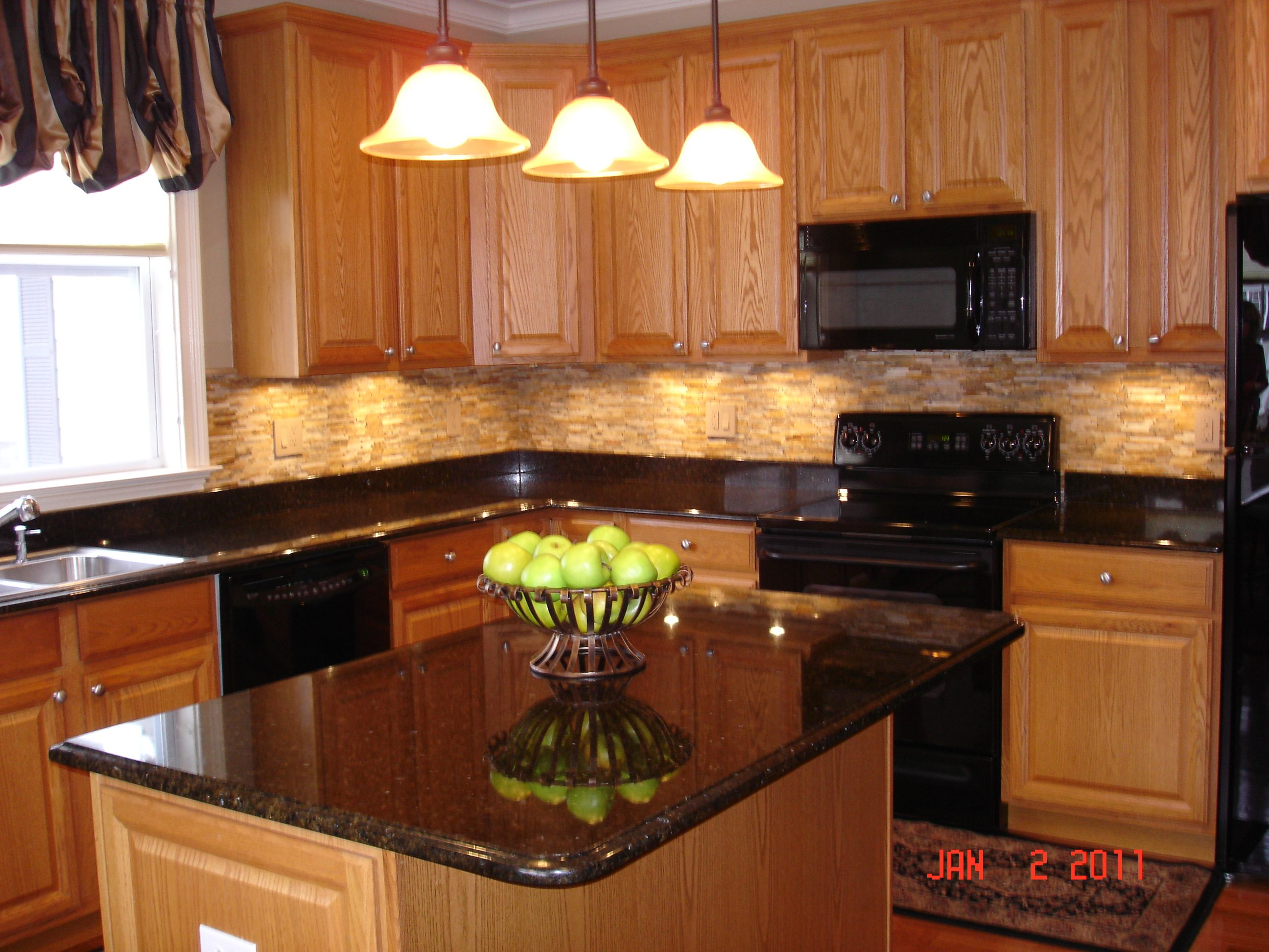 Oak Wood Cabinetstogo With Under Cabinet Lighting And Pendant Lighting Plus Black Granite