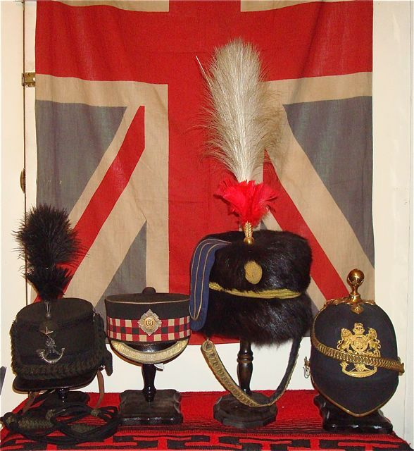 Four Victorian Officers Headgear.L to R Cameronians Scottish Rifles Scots Guards Forage Cap 21st Hussars Busby. Royal Artillery