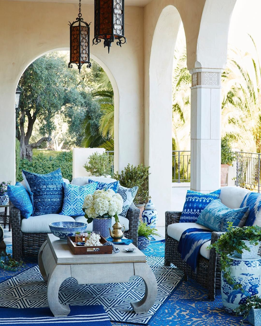 Bungalow the kitchen outdoor living space stone textile at home - Beautifully Bohemian Outdoor Patio Decked Out With Patterned Blue And White Textiles