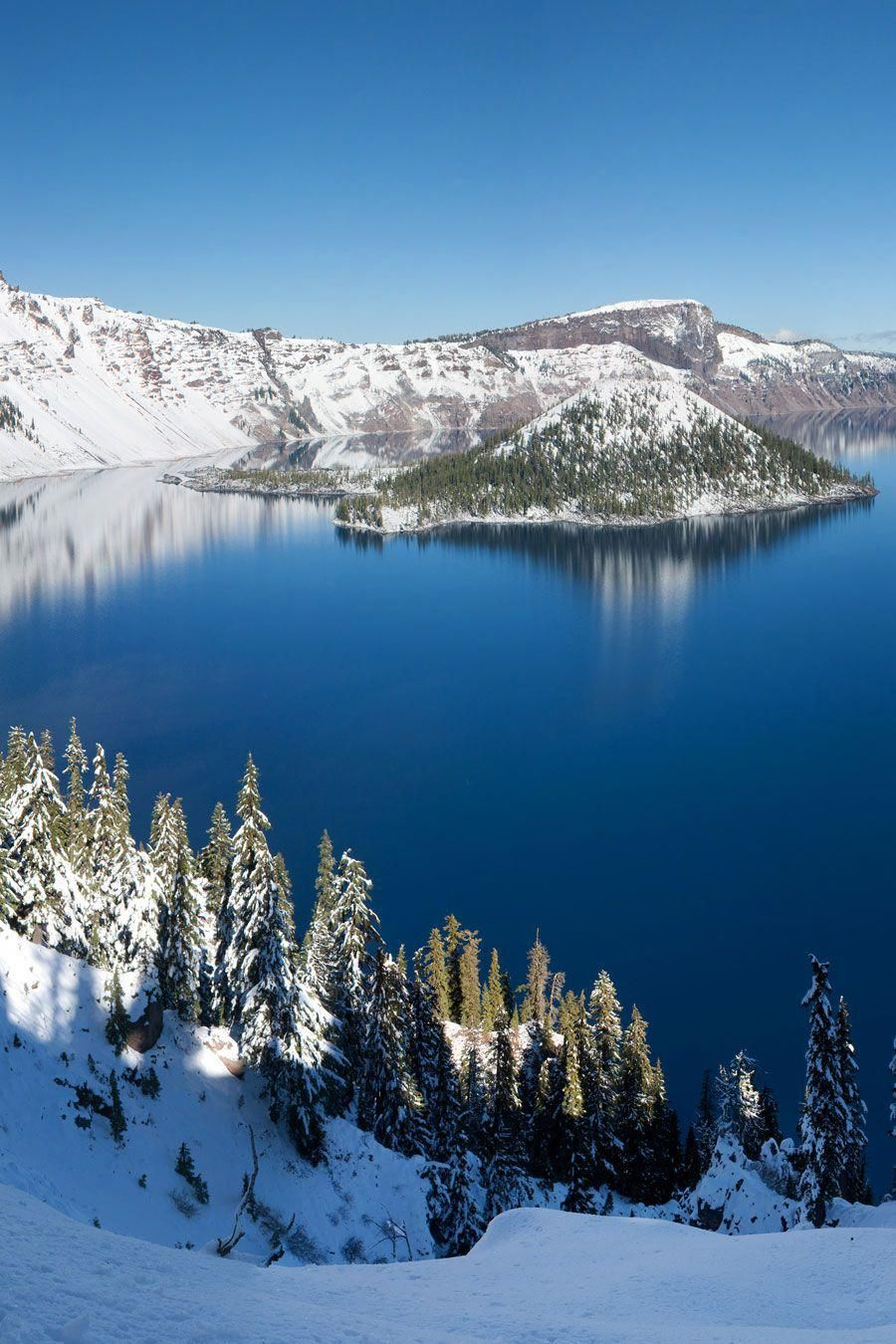 Visiting Crater Lake National Park, Oregon: This crystal clear mountaintop lake formed 7,700 years ago when a volcanic eruption blew the top off of Mount Mazama. The winter is LONG at Crater Lake and the area gets a ton of snow, so it can be hard to time your trip so you don't get there during a blizzard. (I keep trying...) #craterlakenationalpark Visiting Crater Lake National Park, Oregon: This crystal clear mountaintop lake formed 7,700 years ago when a volcanic eruption blew the top off of Mo #craterlakenationalpark