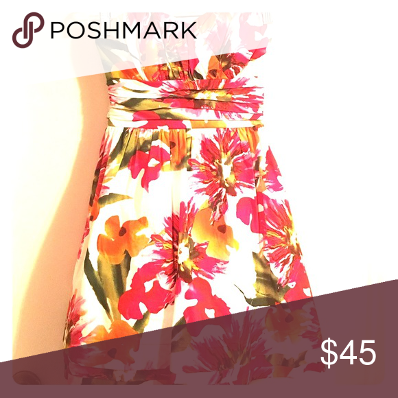 Tropical Strapless Dress Gorgeous and comfortable tropical dress. Strapless with a full skirt and large bow in the back. Worn only once to a tropical themed wedding. WINDSOR Dresses Strapless