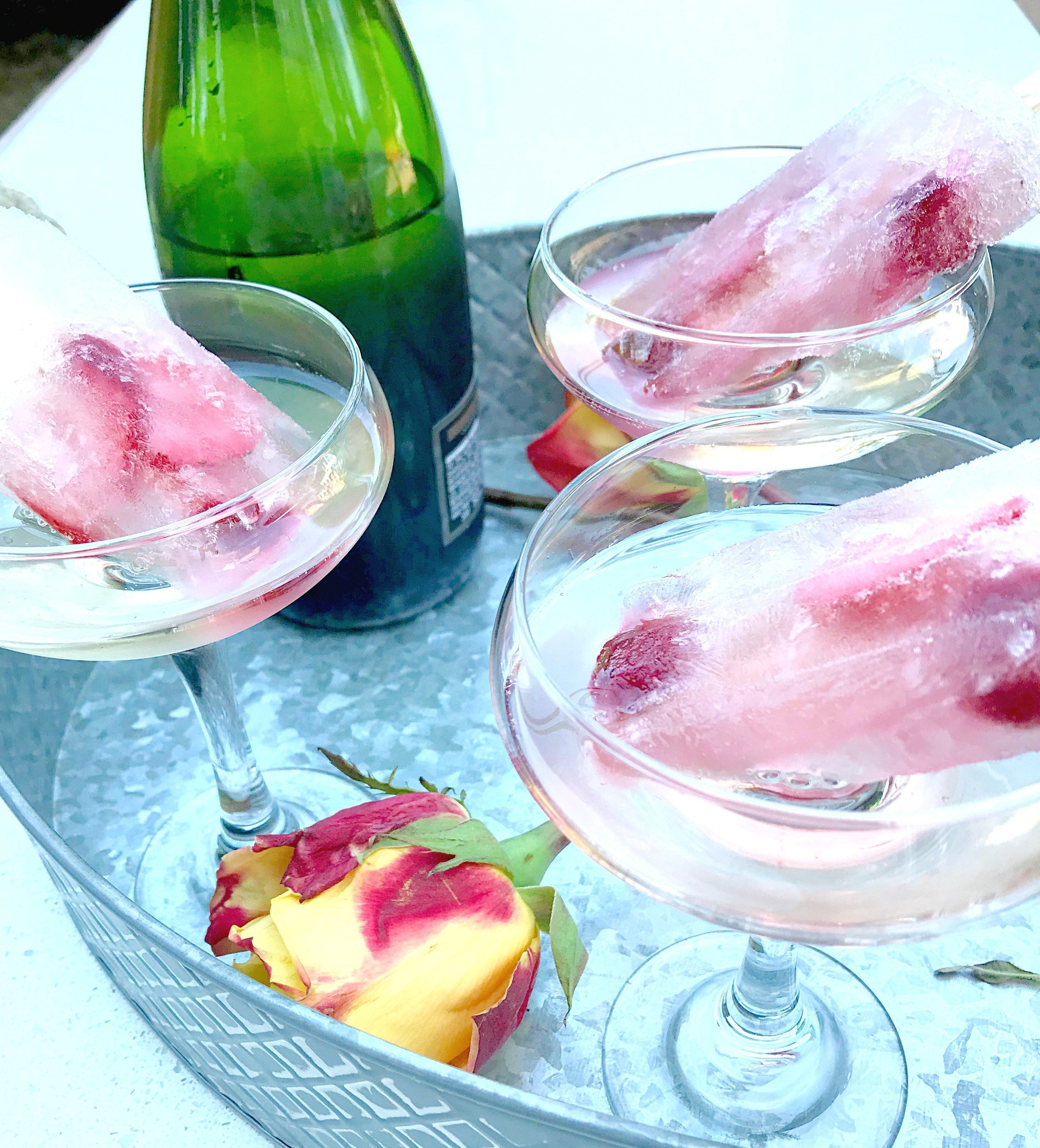 Champops? Champagne pops? Champagne popsicles? Call them whatever you want, or don't call them anything. Just try them! These berry pretty champops are an easy way to step up your entertaining game this summer. They are the perfect boozy summer treat, and unarguably the best way to keep your glass of champagne cold. Seriously, what better way to chill your champagne than with champagne? Move over frozen grapes, it's champops times to shine. #champagnepopsicles Champops? Champagne pops? Champ #champagnepopsicles