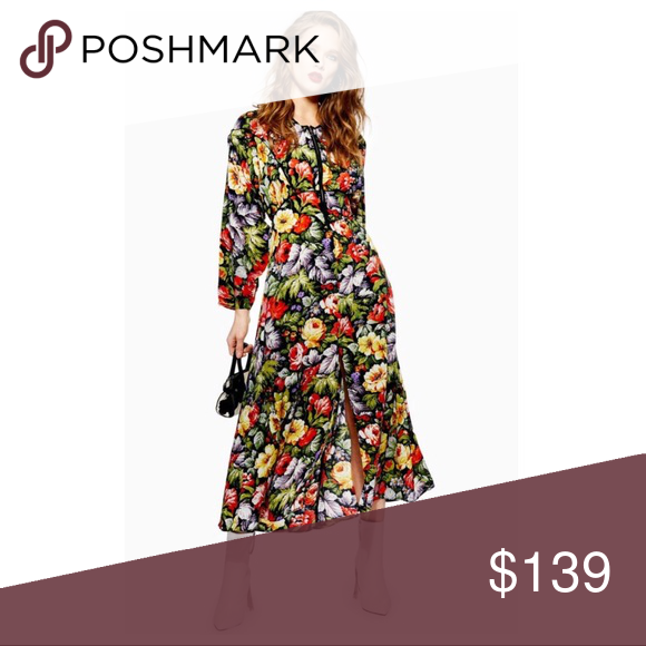 TOPSHOP FLORAL ZIP THROUGH MIDI DRESS TOPSHOP FLORAL ZIP THROUGH CREPE MIDI DRESS  NEW WITHOUT TAGS  SIZE- Tagged size 2 (ze XS)  DETAILS: - Concealed zip fastening at front - Round neck - Long sleeves - All-over floral print - Elasticized at back -Cutout at back -Flared skirt  MATERIAL- 100% Polyester COLOR- Multi  Topshop Dresses Midi