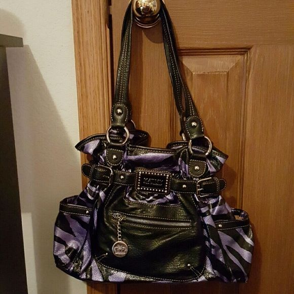 Kathy Van Zeeland purse This purse is a great statement piece! It is purple zebra  print and super edgy. The only signs of wear are a scrape on the bottom ... b90e7da9e0608