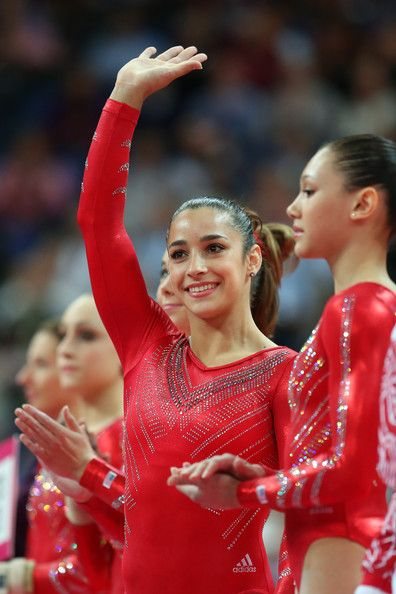 Aly Raisman Photos Photos - Alexandra Raisman of the United States waves as she is introduced in the Artistic Gymnastics Women's Team final on Day 4 of the London 2012 Olympic Games at North Greenwich Arena on July 31, 2012 in London, England. - Olympics Day 4 - Gymnastics - Artistic