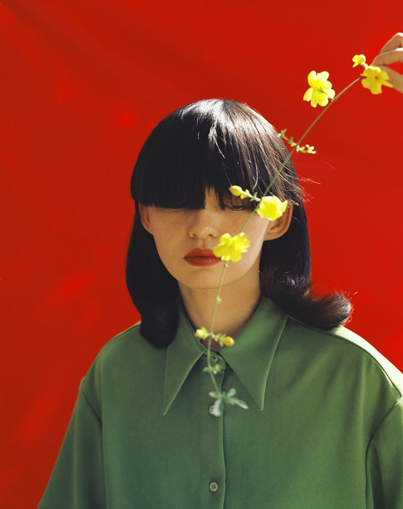 Shanghai-based photographer Leslie Zhang's work encompasses striking portraits with bold colors, atmospheric documentary shots and stylized fashion commissions.