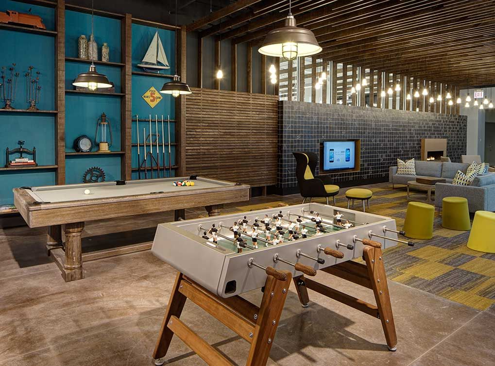 24 Hour Lounge With Fireplace Tvs Billiards And Foosball